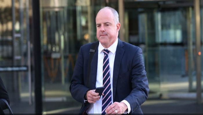 Suncorp executive David Carter leaves the Royal Commission in Melbourne. Photo: AAP