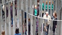 People wander through a maze of mirrored panels at the National Gallery of Victoria. Photo by Scott Barbour/Getty Images