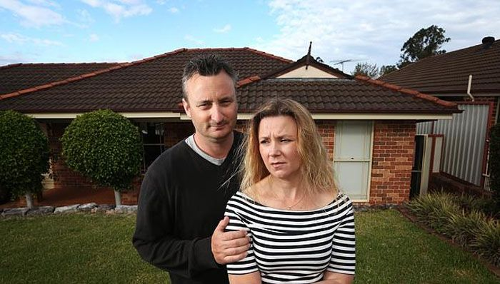 Rebecca Dillon and husband Glenn in front of their Glenmore Park home in Western Sydney. Source: News Corp Australia